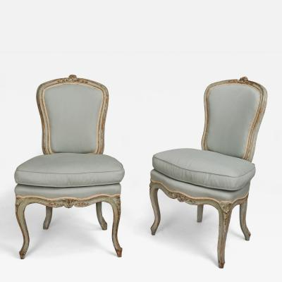 A Pair of Painted Wood Chairs chaises en cabriolet