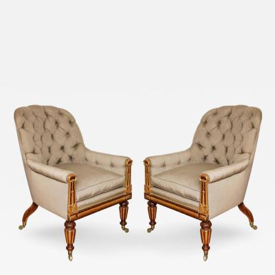 A Pair of Parcel Gilt Regency Library Chairs