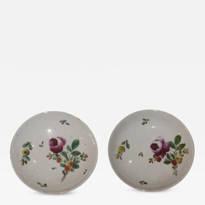 A Pair of Porcelain Saucers Painted with Floral Decoration