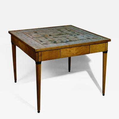 A Pear Wood Biribi Games Table with Inlaid Ebony and Tapered Legs and Ball Feet