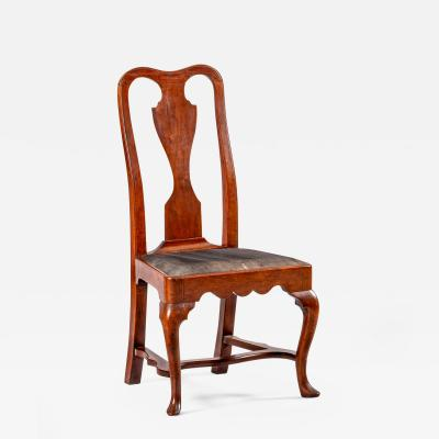 A Philadelphia side chair with original leather seat and stretcher base