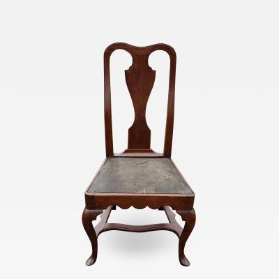 A Philadelphia walnut side chair with original leather seat