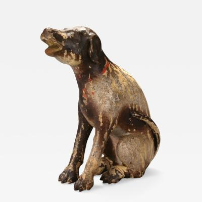 A Philippine Mottled Brown Painted Wood Carving of San Roques Dog