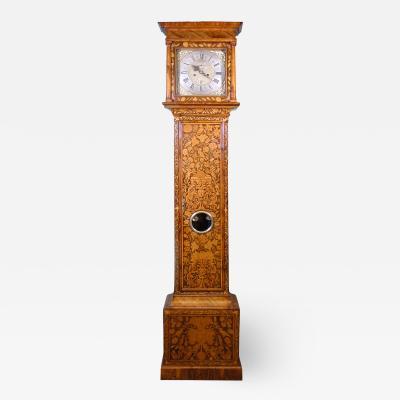 A QUEEN ANNE WALNUT LONGCASE CLOCK