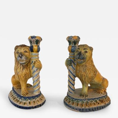 A Rare Pair of Faience Lions