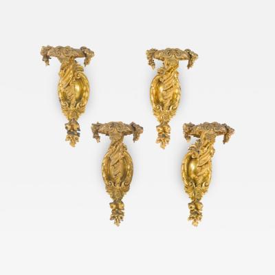 A Rare Set of Four Gilt Bronze Single Branch Wall Sconces