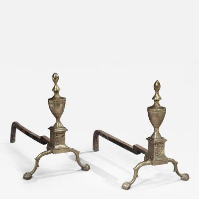 A Rare and Important Pair of Brass Andirons