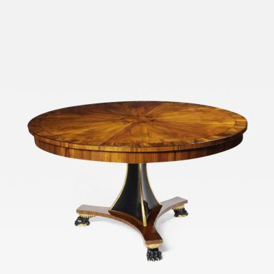 A Regency Style Extendable Single Pedestal Dining Table by Iliad Design