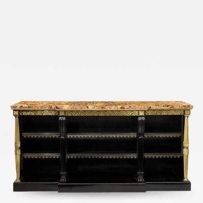 A Regency brass inlaid ebonized breakfront bookcase