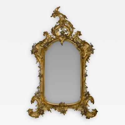 A Rococo Style Giltwood And Silver Gilt Mirror