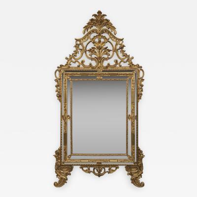A Rococo Style Giltwood Marginal Mirror