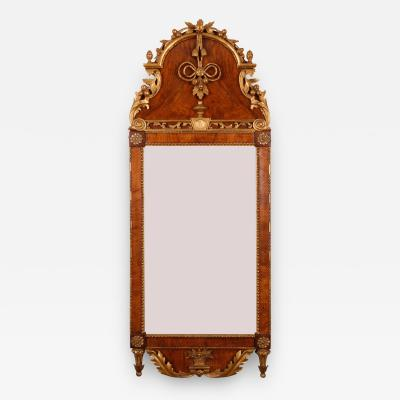 A Rococo Walnut and Parcel Gilt Mirror Danish Schleswig Holstein ca 1780
