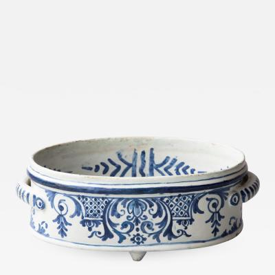 A SMALL FAIENCE TWO HANDLED BASSIN OR JARDINIERE
