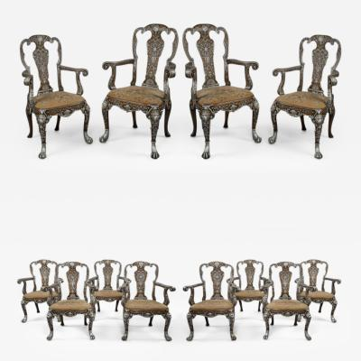 A Set Of Twelve George I Style Dining Chairs