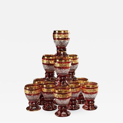 A Set of 12 Ruby and Parcel Gilt Glasses