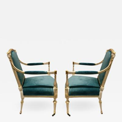 A Set of 4 Painted and Parcel Gilt Arm Chairs
