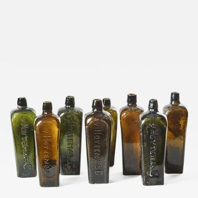 A Set of 8 Gin Bottles