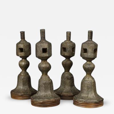 A Set of Four Large Copper Repousse Charpoy Legs