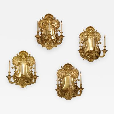 A Set of Four Three Light Wall Appliques