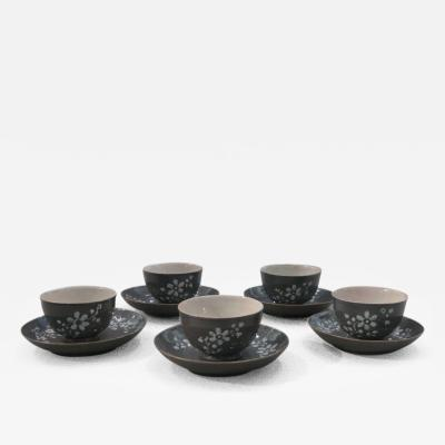A Set of Fve Puce Colored Porcelain Cups and Saucers