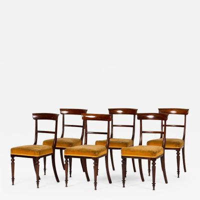 A Set of Six Upholstered Empire Dining Chairs in Rosewood with Exceptional Form