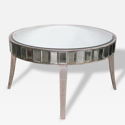 A Shimmering American Circular Cocktail Table with Silver Gilt Wood Supports