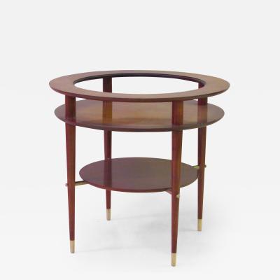 A Sleek Italian Circular Side Table with Glass Top