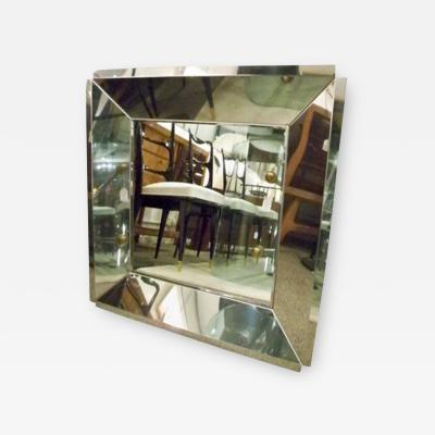 A Square Wall Mirror with a Wide Beveled Chromed Metal Frame