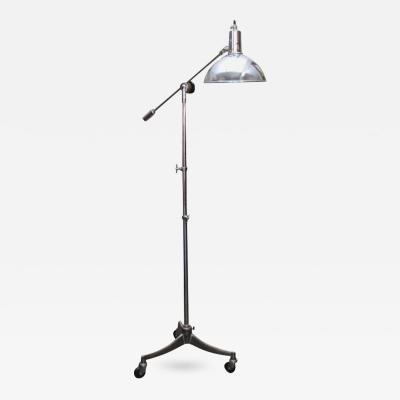 A Standard Adjustable Metal Lamp on Tripod Wheeled Base