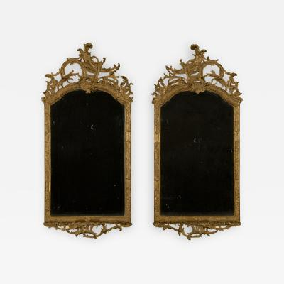 A Superb Pair of Giltwood and Partial Composition Rococo Mirrors
