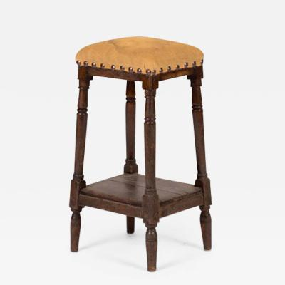 A Tall Upholstered Stool with Lower Shelf