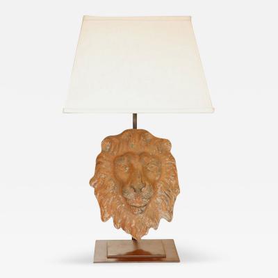 A Terra Cotta Lion Mask as a Lamp on Custom Metal Base