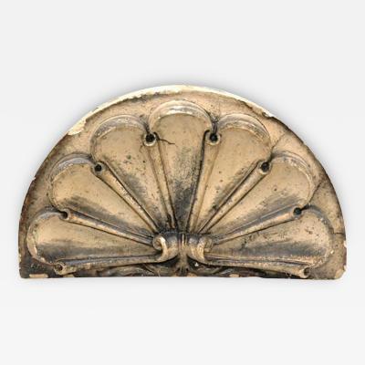 A Terra Cotta over Door in an Elegant Scrolled Fan Form