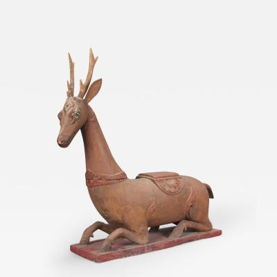 A Thai Carved and Painted Wood Sculpture of a Stag