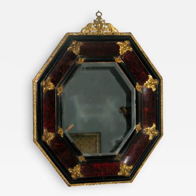A Tortoise Shell Octagonal Mirror with Applied Bronze Putti