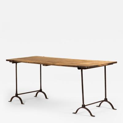 A Trestle Table with Iron Base and Wood Top With Iron Banding