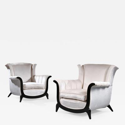A UNUSUAL PAIR OF FRENCH ART DECO EBONISED ARMCHAIRS IN A CRUSHED VELVET