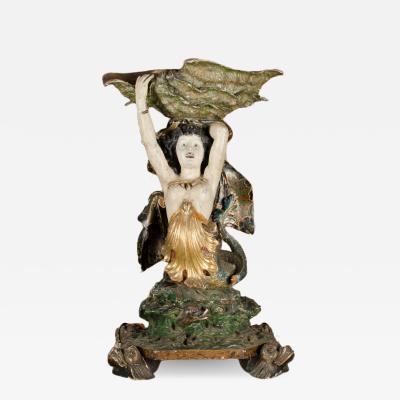 A Venetian Large Mermaid Sculpture holding seashell 19th C