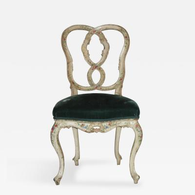 A Very Finely Carved and Painted White Side Chair with an Open Work Back