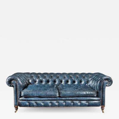 A Victorian 2 seater leather Chesterfield sofa