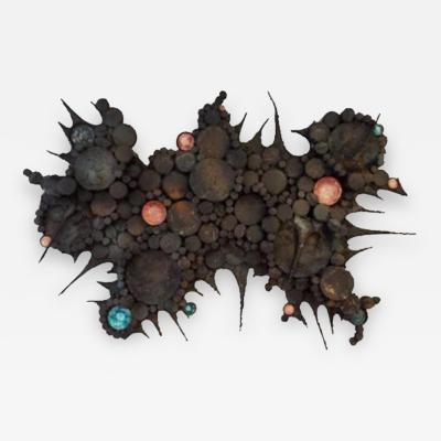 A Wall Sculpture in Blackened Steel and Ceramic