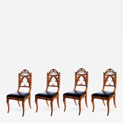 A Well Carved Set of 4 Gothic Revival Walnut Side Chairs