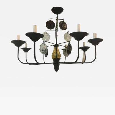 A Wrought Iron Chandelier with Glass Pendants