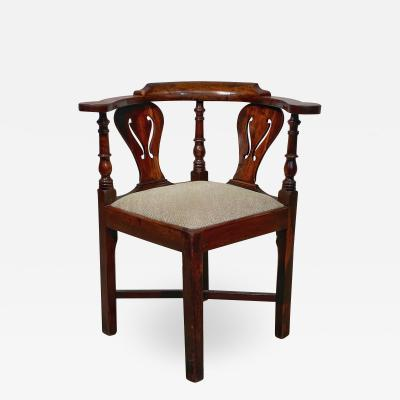 A Yew wood corner chair