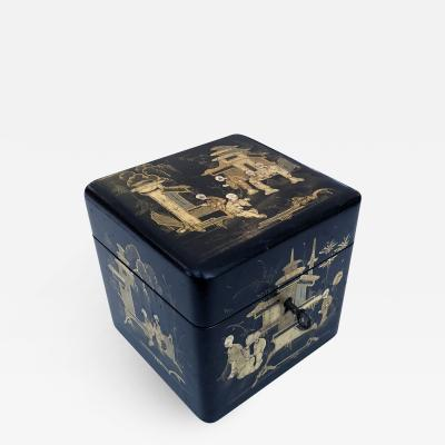 A charming English regency Japanned square form tea caddy