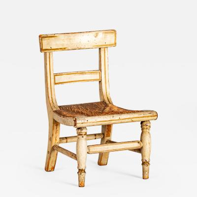 A classical childs size side chair