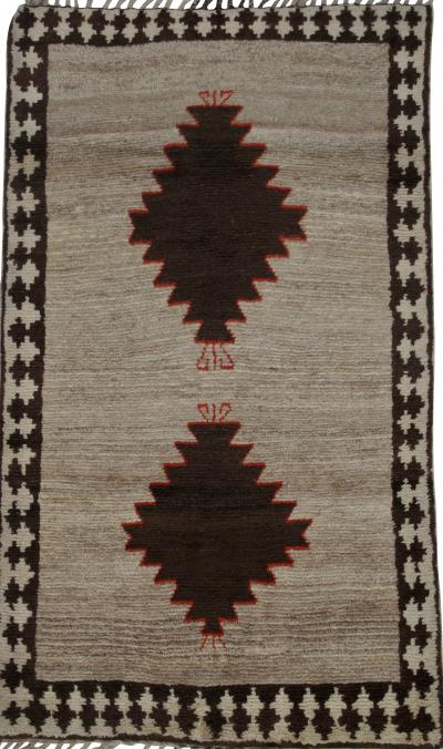 A collection of Persian Gabbeh diamond design rugs Price is for each rug