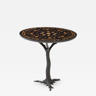 A contemporary round side table Patinated Iron base with a unique art piece top