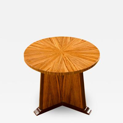 A contemporary round zebra wood table in the Art Deco style