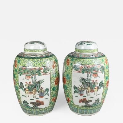 A decorative pair of 19th Century Chinese elongated ginger jars and covers